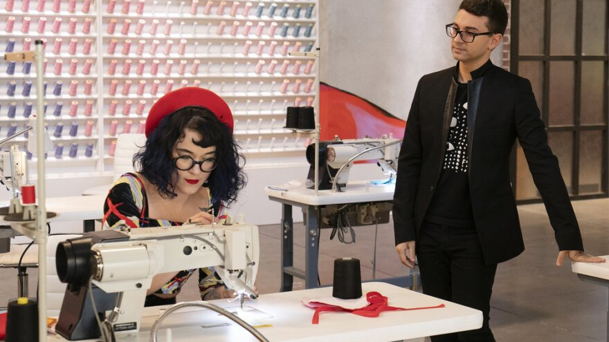 Christian Siriano watches over the work of Hester Sunshine on <em>Project Runway</em>.