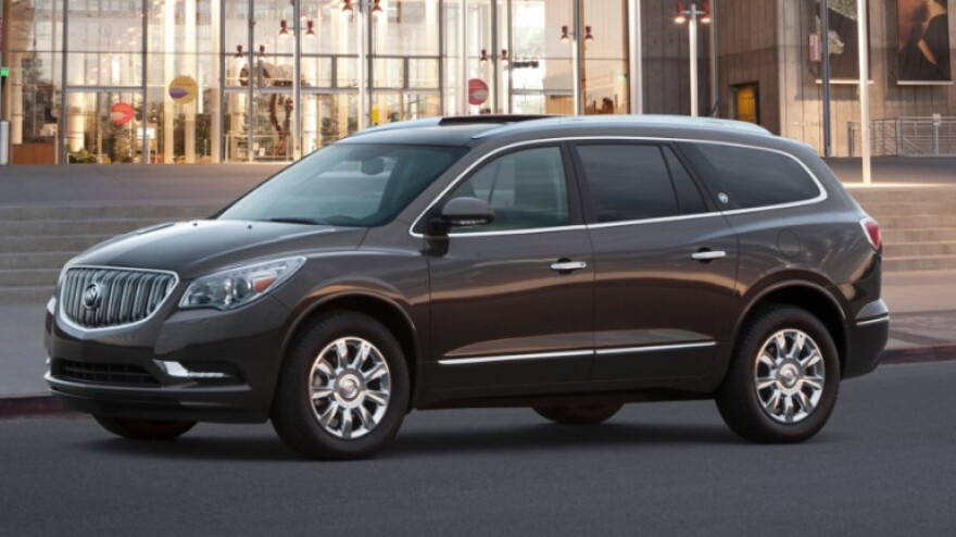 Sales of GM's cars slid by 3.8 percent from July 1013, but its light trucks and SUVs, like this Buick Enclave, more than made up for it, spiking 17.5 percent.