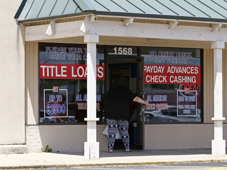 A woman enters an All American Check Cashing location in Brandon, Miss., in May. The Consumer Financial Protection Bureau has proposed new rules to crack down on such lenders.