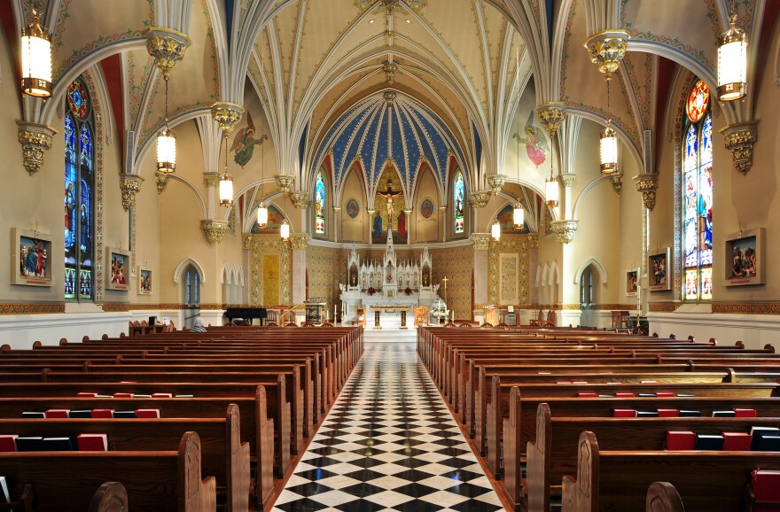 The inside of a Catholic Church sits empty.