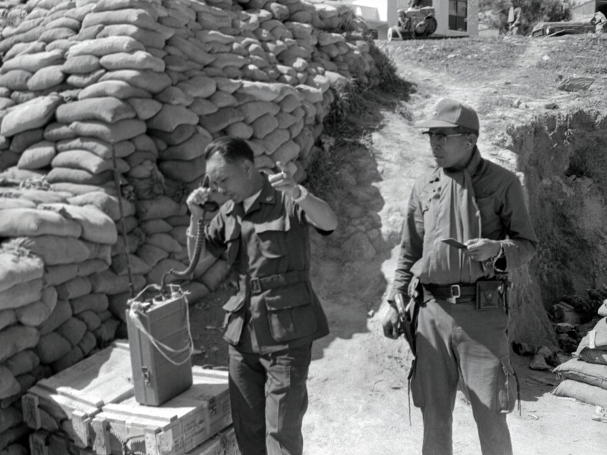 Laotian Gen. Vang Pao, seen here calling in air strikes against suspected Communist positions from the Long Cheng Command Post in January 1972, led an army of Hmong tribesmen to fight against Communist insurgents backed by the North Vietnamese. A CIA-led effort that started in 1961 tried to help him in that fight.