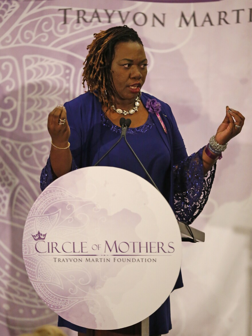 "Queen Thompson Brown, who lost a son to gun violence in 2006, speaks prior to the introduction of Democrat Hillary Clinton at the Trayvon Martin Foundation's ""Circle of Mothers"" Gala."