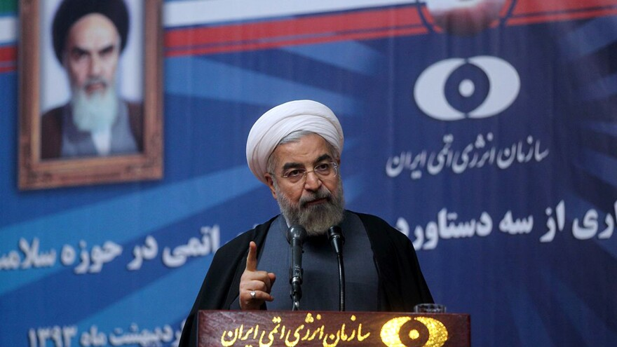 Iran's President Hassan Rouhani speaks to a group of medical and nuclear experts in Tehran on Sunday.