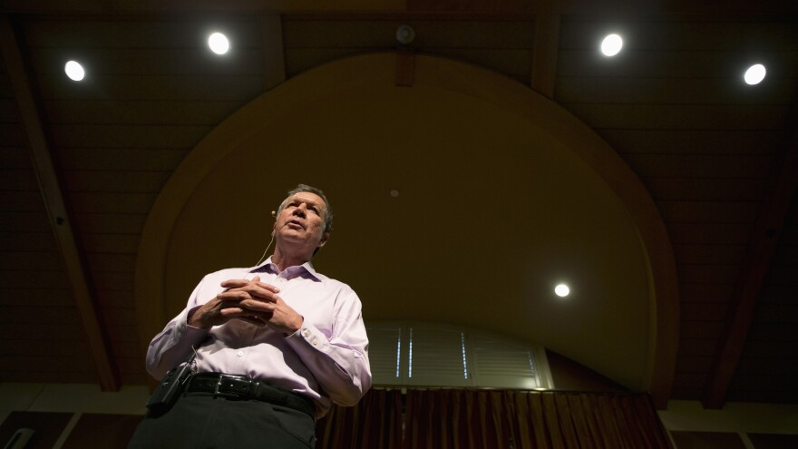 Republican presidential candidate John Kasich's campaign is running an online ad and sent out a fundraising plea in response to the Paris attacks. Kasich is shown here at a town hall campaign event.