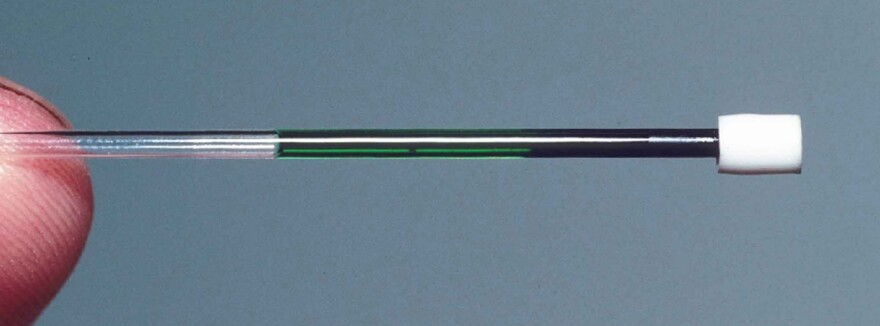 A centrifuge can separate the components of lizard blood. In this tube, red blood cells are on the right and green blood plasma is on the left. This sample came from the green-blooded lizard <em>Prasinohaema prehensicauda, </em>which lives in the highlands of New Guinea.