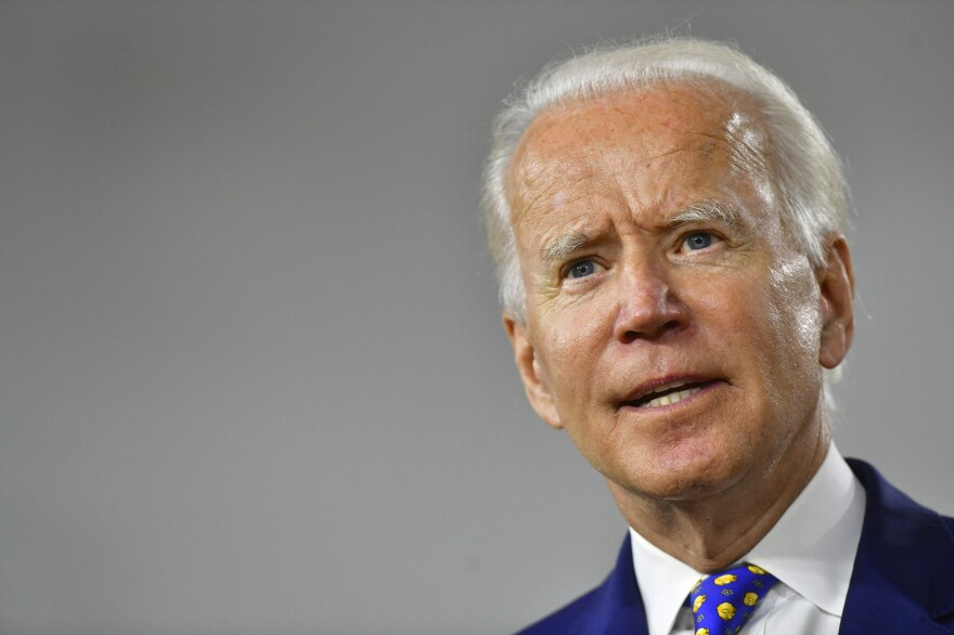 Presumptive Democratic presidential nominee former Vice President Joe Biden delivers a speech in Wilmington, Del., on July 28. The campaign announced Wednesday he would not travel to Milwaukee for the Democratic convention.