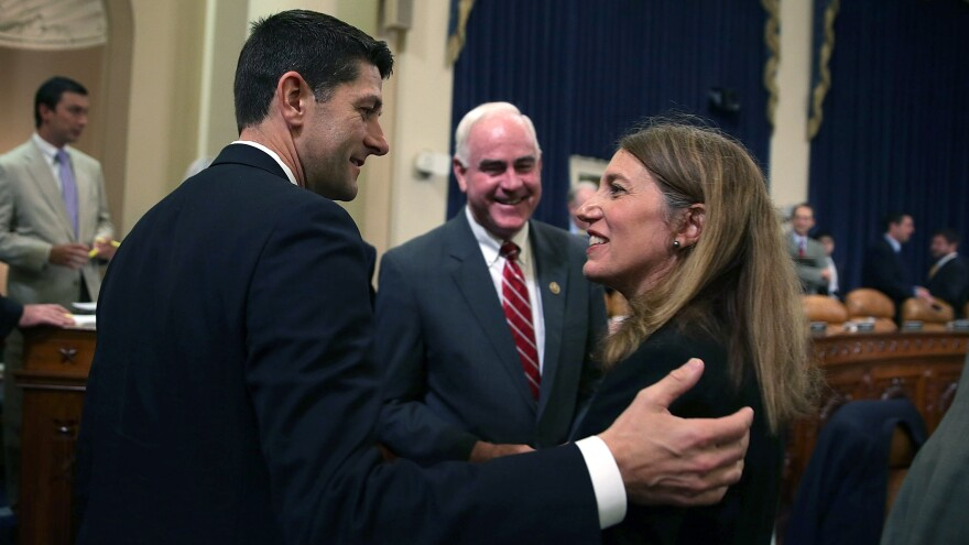 Secretary of Health and Human Services Sylvia Burwell talks before a Capitol Hill hearing Wednesday with Rep. Paul Ryan, R-Wis., as Rep. Pat Meehan, R-Pa., looks on.
