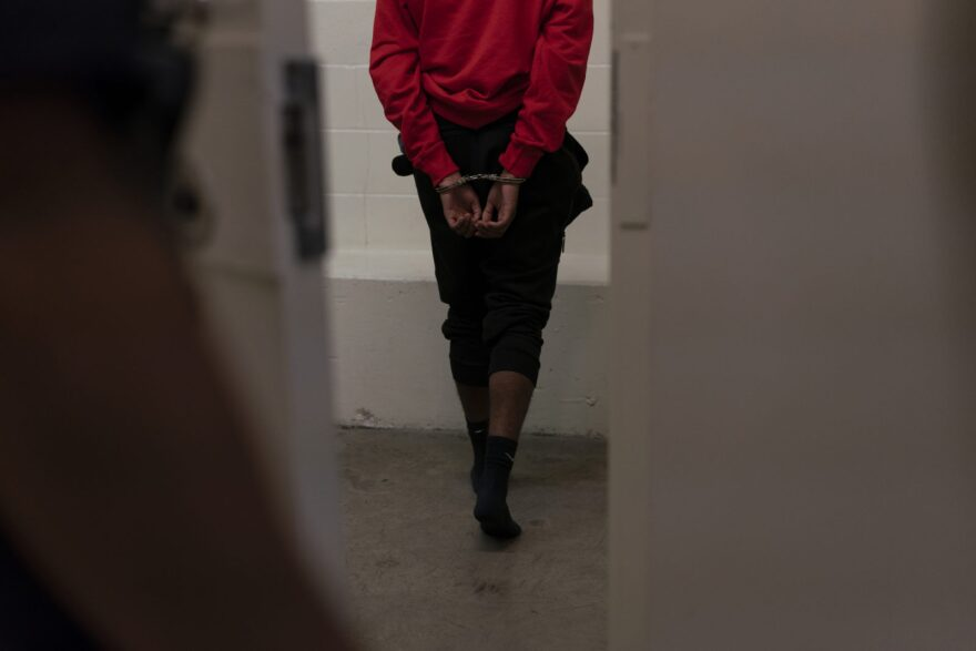 A 17-year-old walks into a jail cell after police found him in a car with a loaded gun in front of a high school homecoming football game in Northeast Portland on Sept. 21, 2018 in Oregon.