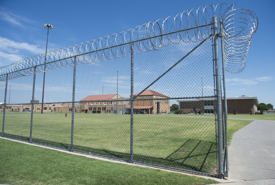The prison yard at the El Reno Federal Correctional Institution in El Reno, Okla., is seen during a visit by President Obama in July. Obama has advocated for prison reform during his time in office. Thousands of inmates are being released as the result of some changes in federal sentencing guidelines.