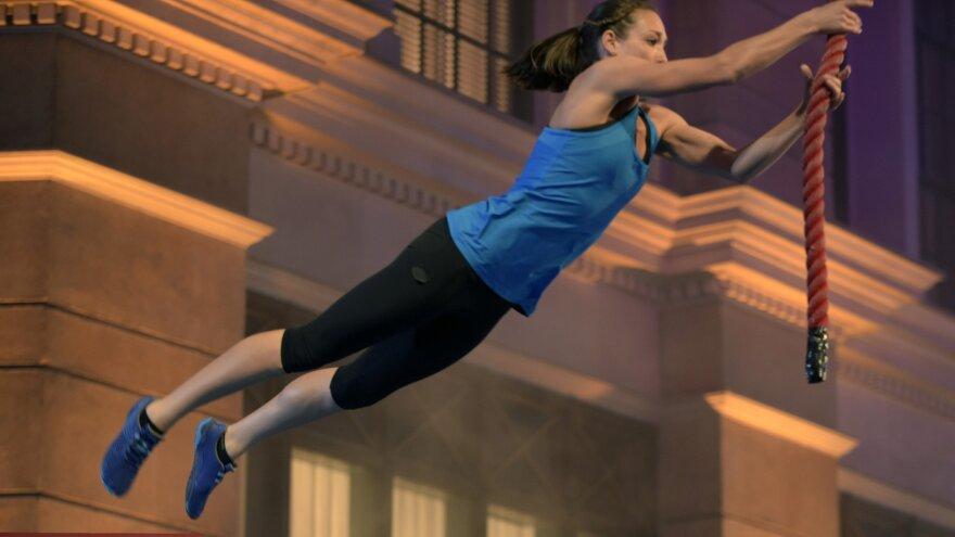 Intelligence officer Tory Garcia, who has a background in gymnastics and diving, works through the obstacle course on <em>American Ninja Warrior, </em>which airs on NBC and Esquire Network.