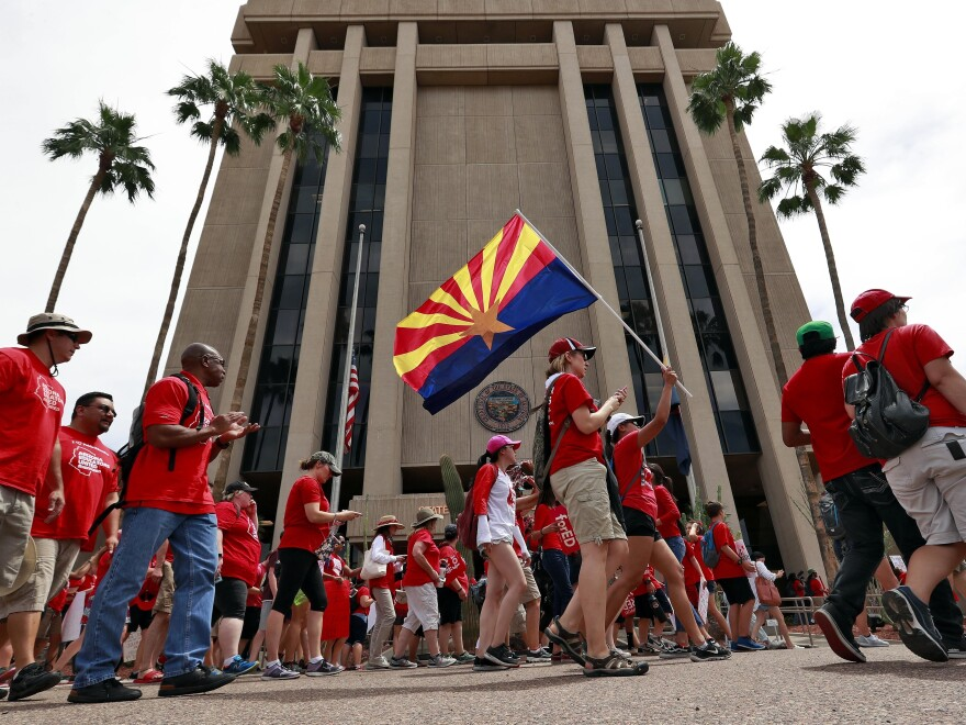 Teachers rally outside Arizona Gov. Doug Ducey's executive tower in Phoenix on Monday, their third day of walkouts. On Wednesday, the educators opened the possibility of ending the walkouts on Thursday, one week after they began.