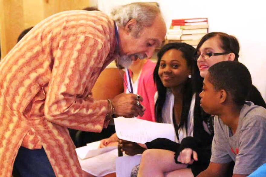 In this file photo, St. Louis Poet Laureate Michael Castro talks with students at an event presented by the 7th Grade Poetry Foundation.