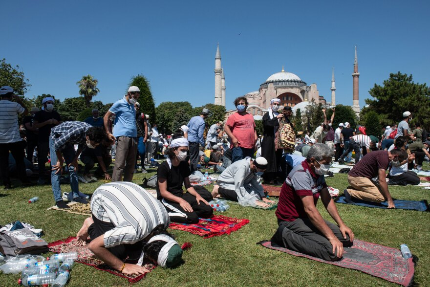 People pray outside Hagia Sophia during the first official Friday prayers since the famous building's conversion from a secular space into a Muslim house of worship.