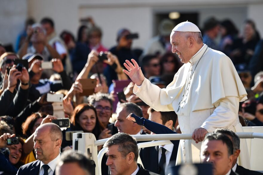 Pope Francis greets the crowd in the Vatican's St. Peter's Square in October. Many of the pope's most vocal opponents are in the United States, attacking him in tweets, blogs and politically conservative media.