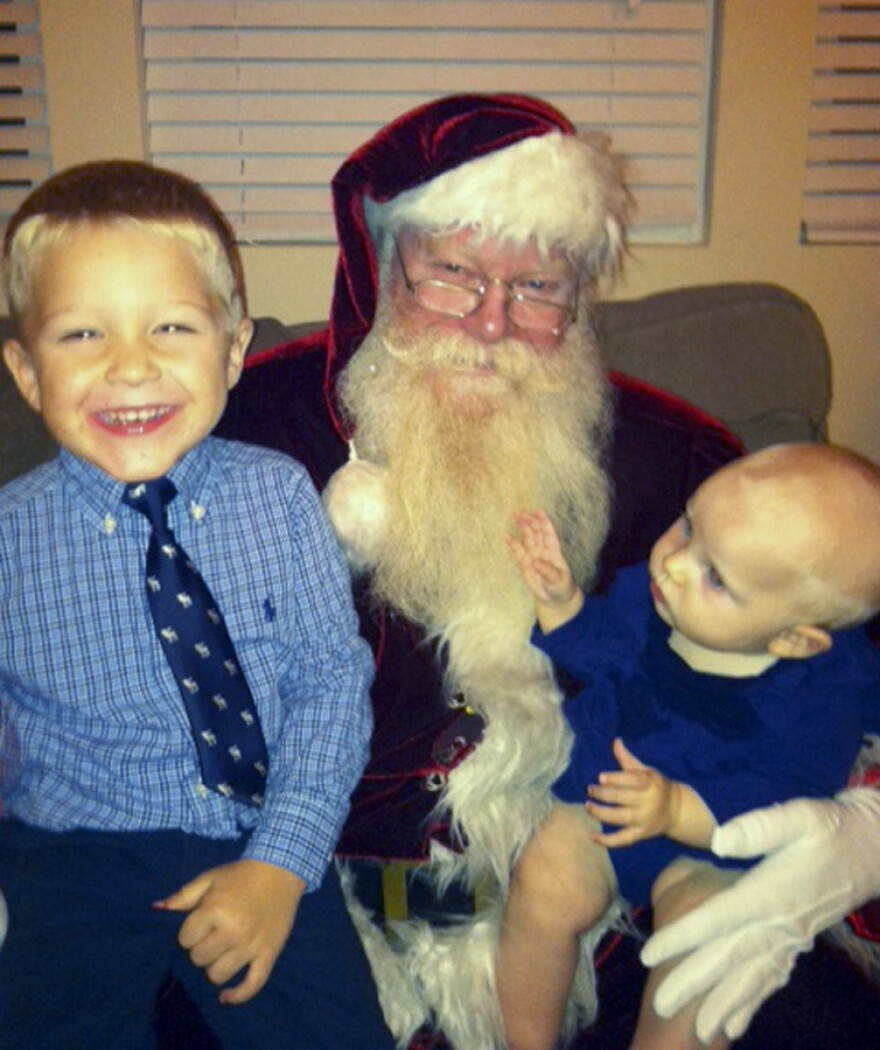 Applegate drops by a neighborhood Christmas party on Dec. 8. He says he fully commits to the character of Santa Claus, leaving Applegate at the door every time he suits up.