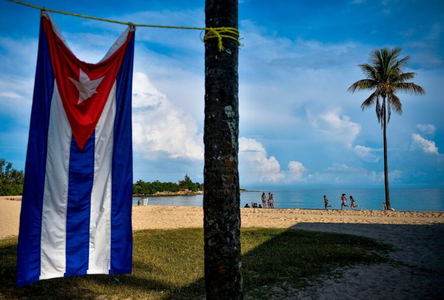 A Cuban flag is seen at Bacuranao beach in Havana. Raúl Castro is expected to resign as the leader of Cuba's Communist Party in April.