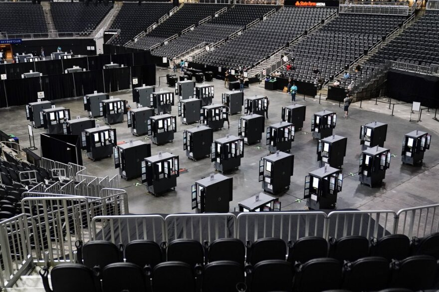 Voting machines are lined up on the floor of State Farm Arena.