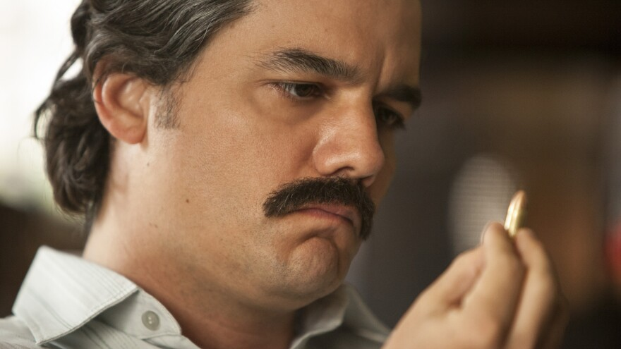"""When he was cast in his <em>Narcos</em> role, Moura says, """"I didn't look like Pablo Escobar at all."""""""