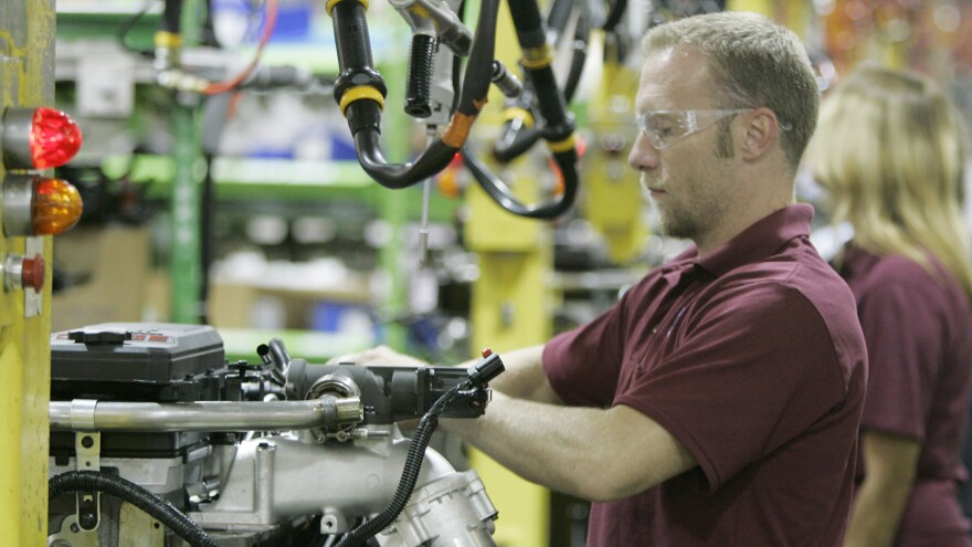 An engine is assembled at a Cummins plant in Columbus, Ind., in 2007. The <em>Fortune</em> 500 company sells diesel engines around the world.