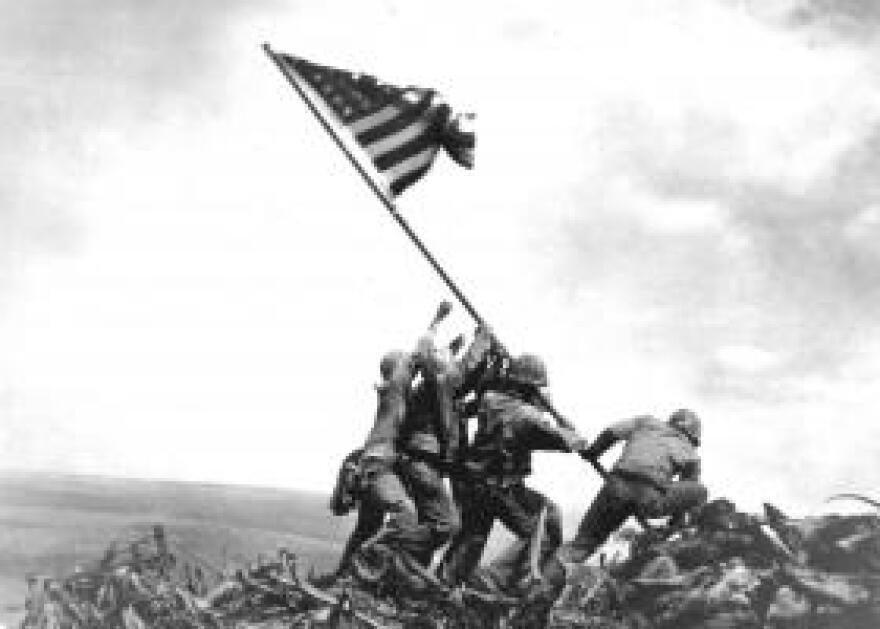 The iconic photograph of Marines raising the American Flag on Mount Suribachi, Iwo Jima, February 23, 1945.