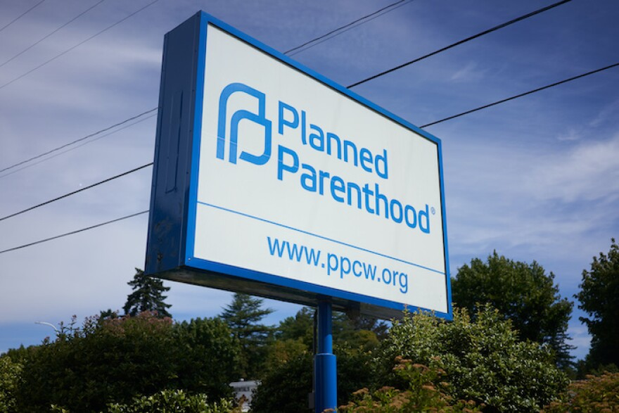 Milwaukie, OR, USA - Aug 20, 2020: The signpost outside the Planned Parenthood Milwaukie-Oak Grove Health Center. Planned Parenthood is a nonprofit organization that provides reproductive health care.