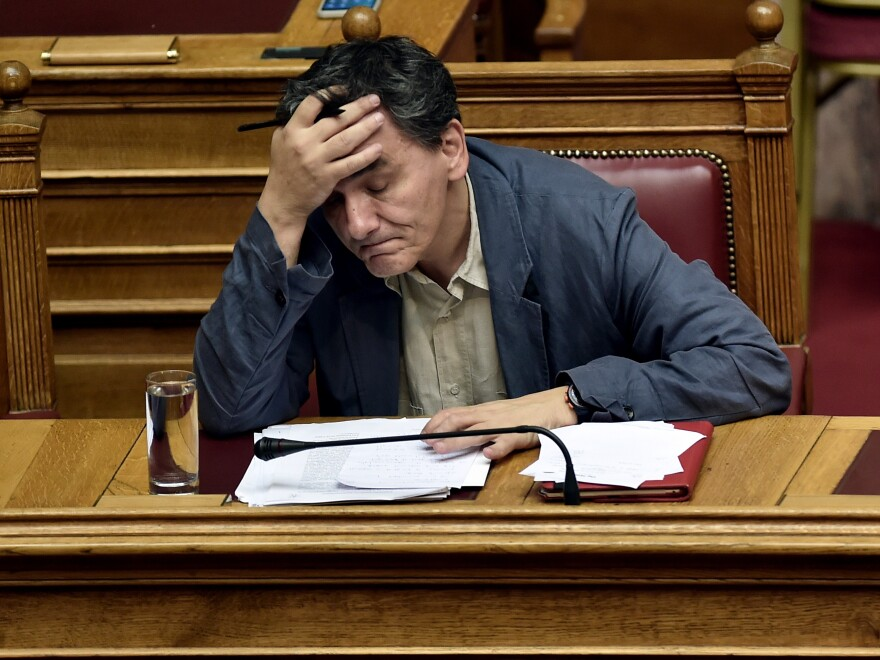 Greek Finance Minister Euclid Tsakalotos attends a session of Parliament in Athens on Wednesday as lawmakers prepared to vote on reforms demanded by eurozone creditors in exchange for a new bailout.