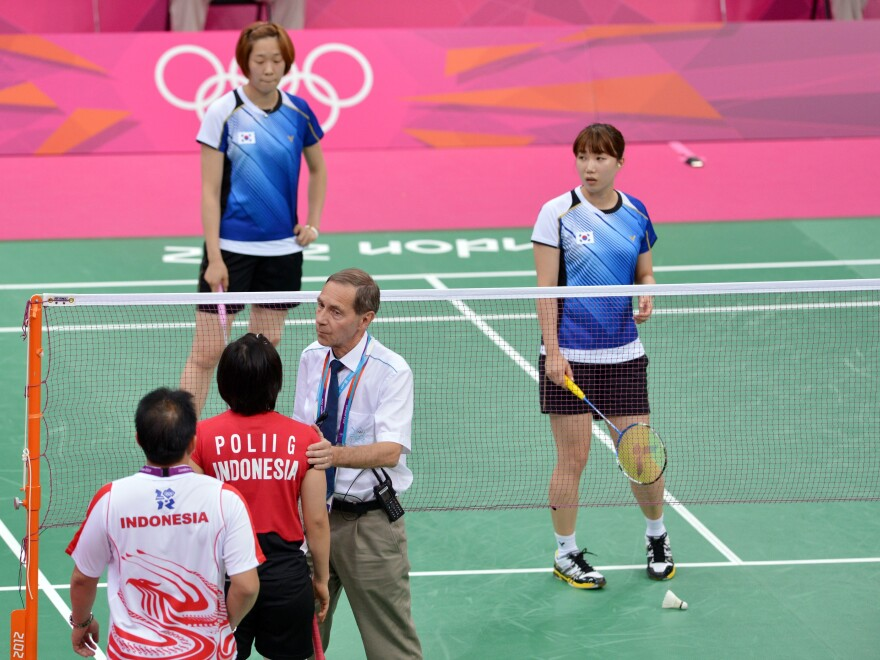 Referee Torsten Berg tried to get players from Indonesia (near court) and South Korea to try their hardest during this match at the London Olympics. The format gave some teams an incentive to lose — in order to get easier opponents in upcoming matches. That format's being changed.