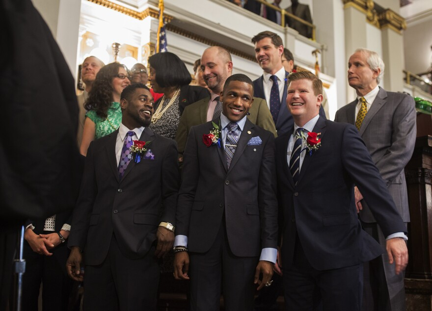Aldermen, including Brandon Bosley, John Collins-Muhammad and Jack Coatar, front row, get ready to take the oath of office in the Aldermanic chambers. (April 18, 2017)