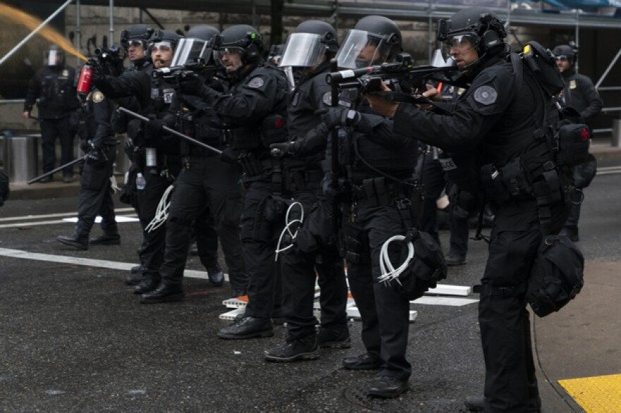 Portland police fire pepper spray, FN 303 plastic munitions, and aim a 40mm launches while dispersing protesters from near the Justice Center an hour before the 8p.m. curfew went into effect on May 30, 2020. The protests were against racist violence and police brutality in the wake of the Minneapolis police killing of George Floyd.