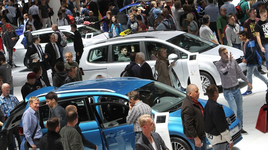 Fair goers visit the booth of German car maker Volkswagen at the 66th IAA auto show in Frankfurt am Main, western Germany, on Sept. 22, 2015. German auto giant Volkswagen revealed that 11 million of its diesel cars worldwide are equipped with devices that can cheat pollution tests.