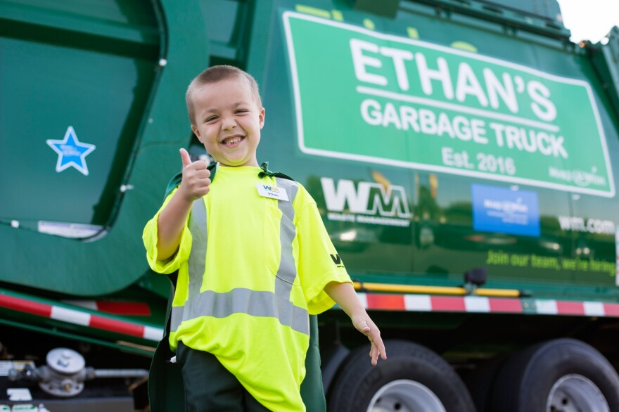 Ethan Dean, a 6-year-old boy with cystic fibrosis, rode in a garbage truck on Tuesday as part of an event organized by the Make-a-Wish Foundation and local sponsors.