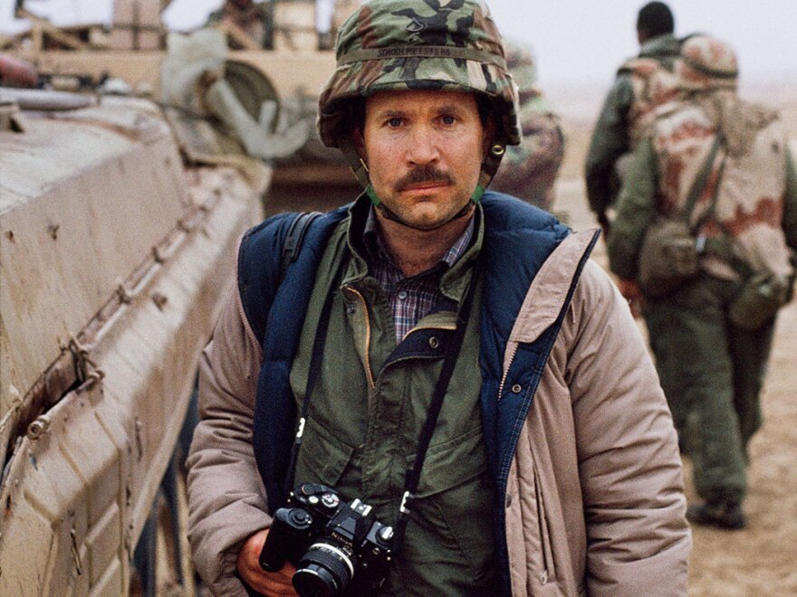 <em>National Geographic</em> photographer Steve McCurry, shown in Kuwait in 1991, says his big break came at a refugee camp near Peshawar, Pakistan, after he heard the sound of children laughing.