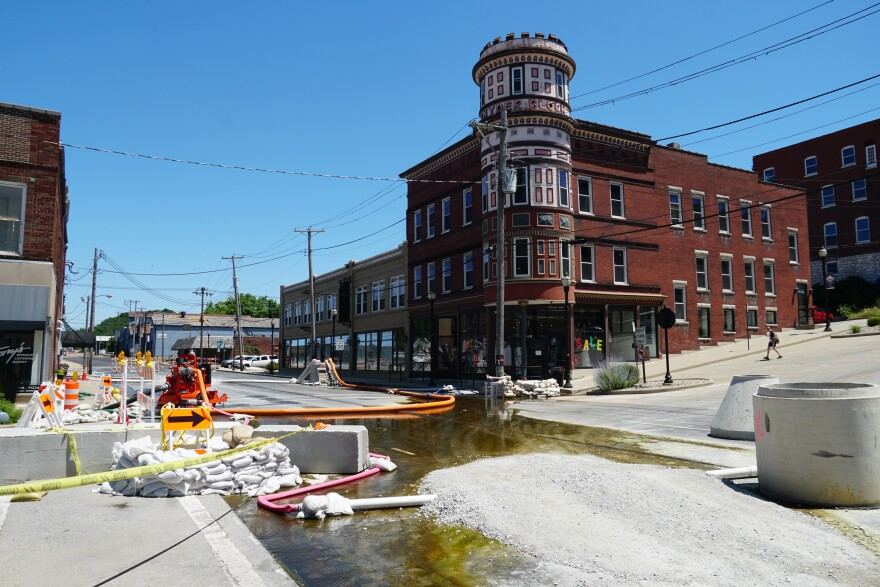 Many businesses in downtown Alton remain open as Alton Public Works staff and the Illinois National Guard work on the streets. June 10, 2019