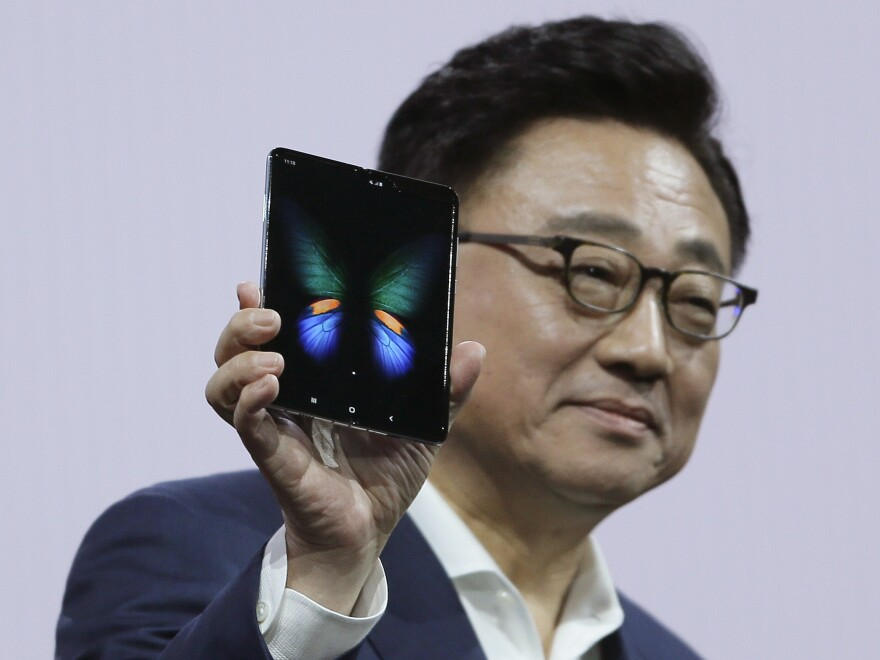 Samsung executive DJ Koh holds up the new Galaxy Fold smartphone during an event on Feb. 20 in San Francisco. On Monday, the company announced it is delaying the device's launch.