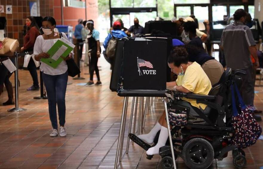 Steady flow of voters cast their ballots at the Stephen P. Clark Government Center in downtown Miami, as Florida began its first day of early voting on Monday, October 19, 2020.