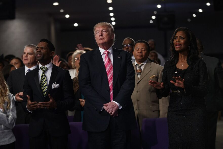 Republican presidential candidate Donald Trump, center, looks on during a church service at Great Faith Ministries, Saturday, Sept. 3, 2016, in Detroit. (Evan Vucci/AP)
