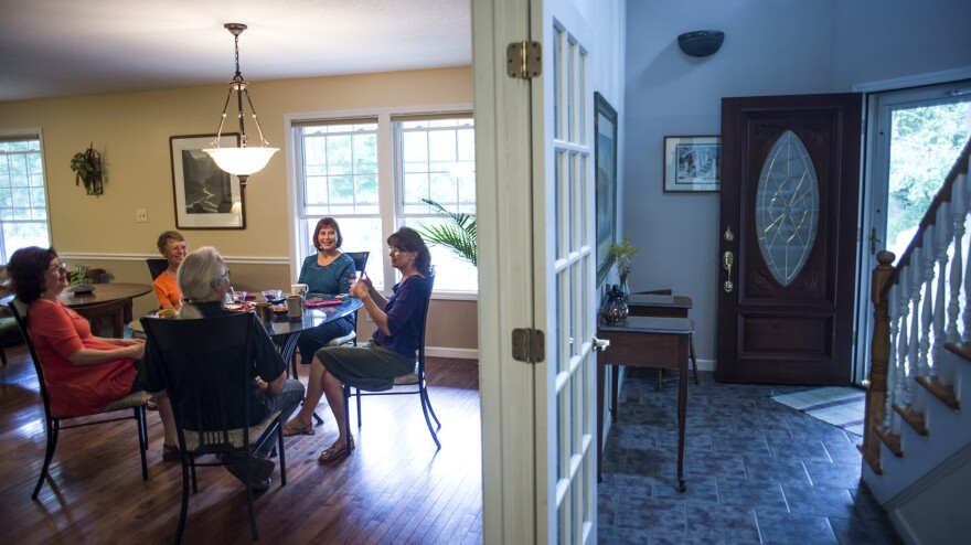 Group houses are becoming popular — again — among some single baby boomers, and not just for financial reasons. Marianne Kilkenny (second from right) shares her home in Asheville, N.C, with four other people.