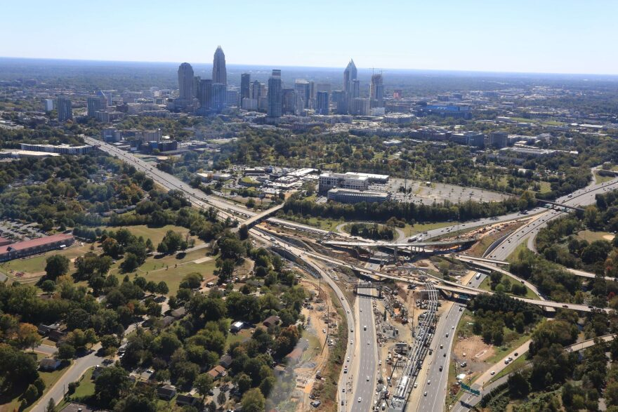 An aerial view of the I-77 Express Lanes construction near uptown Charlotte in October shows a new westbound ramp under construction from I-277 westbound to I-77 southbound.