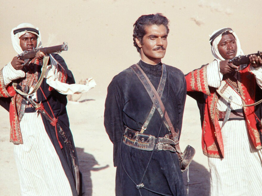 "Dark and handsome, with a strong accent, Sharif —€"" seen here in 1962's <em>Lawrence of Arabia</em> —€"" didn't look like the movie stars audiences were used to."