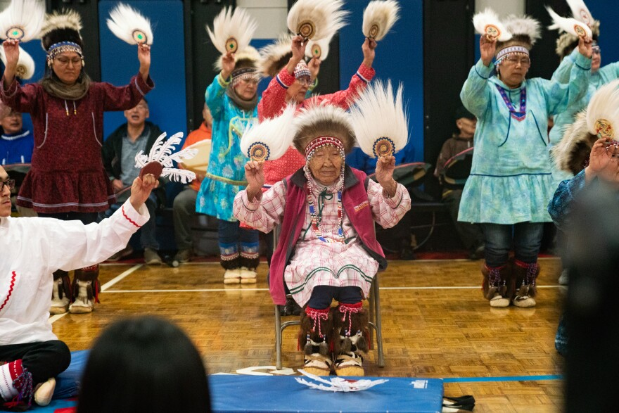 Lizzie Chimiugak Nenguryarr  (center), the first person counted for the 2020 census, joins in the Yup'ik dancing at the ceremony on Tuesday.