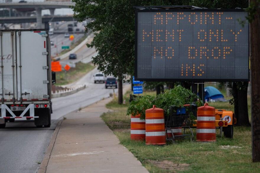 A sign at the entrance to Austin Public Health's drive-thru coronavirus testing site.