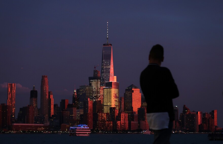 The sun sets on Lower Manhattan and One World Trade Center in New York City on Sept. 2 as seen from Hoboken, N.J.