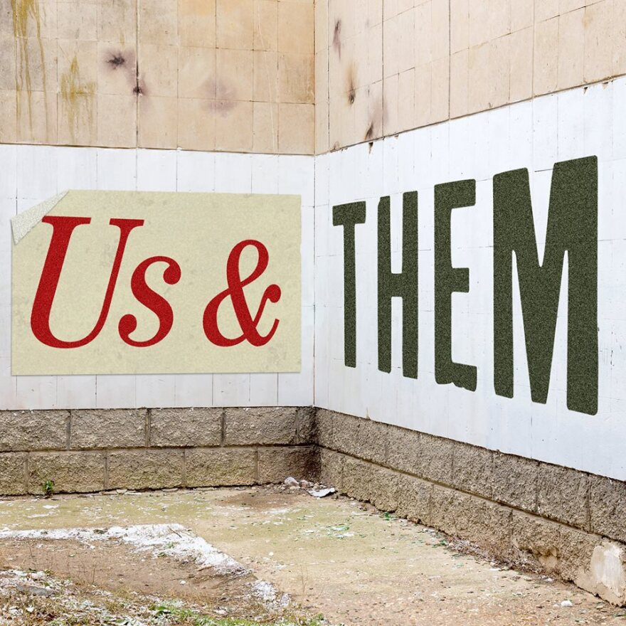 Us & Them Logo