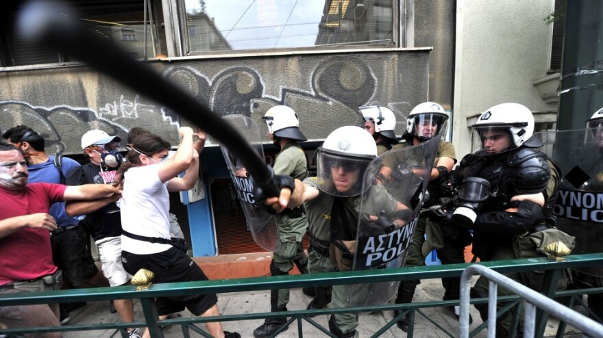 Protesters clash with riot police during a 48-hour general strike in Athens on Wednesday.