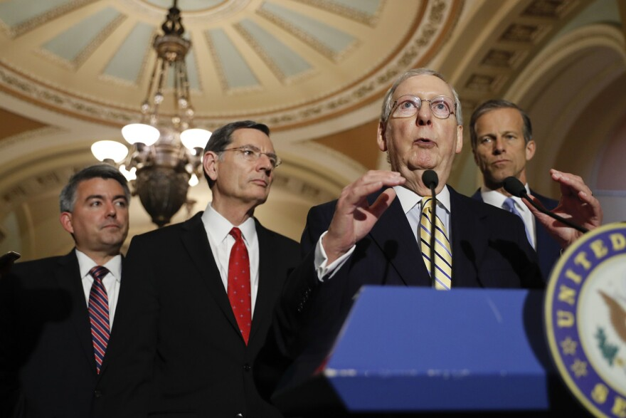 Senate Majority Leader Mitch McConnell of Ky., accompanied by, from left, Sen. Cory Gardner, R-Colo., Sen. John Barrasso, R-Wyo., and Sen. John Thune, R-S.D., speaks to reporters on Capitol Hill in Washington, Tuesday, May 2, 2017, following a policy luncheon. (AP Photo/Pablo Martinez Monsivais)
