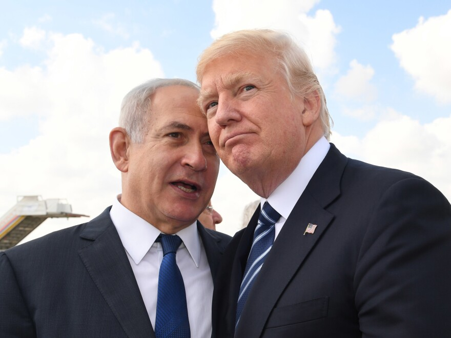 Israeli Prime Minister Benjamin Netanyahu speaks with President Trump prior to the President's departure from Ben Gurion International Airport in Tel Aviv on May 23, 2017, in Jerusalem. The visit was part of Trump's first Middle East trip after taking office.