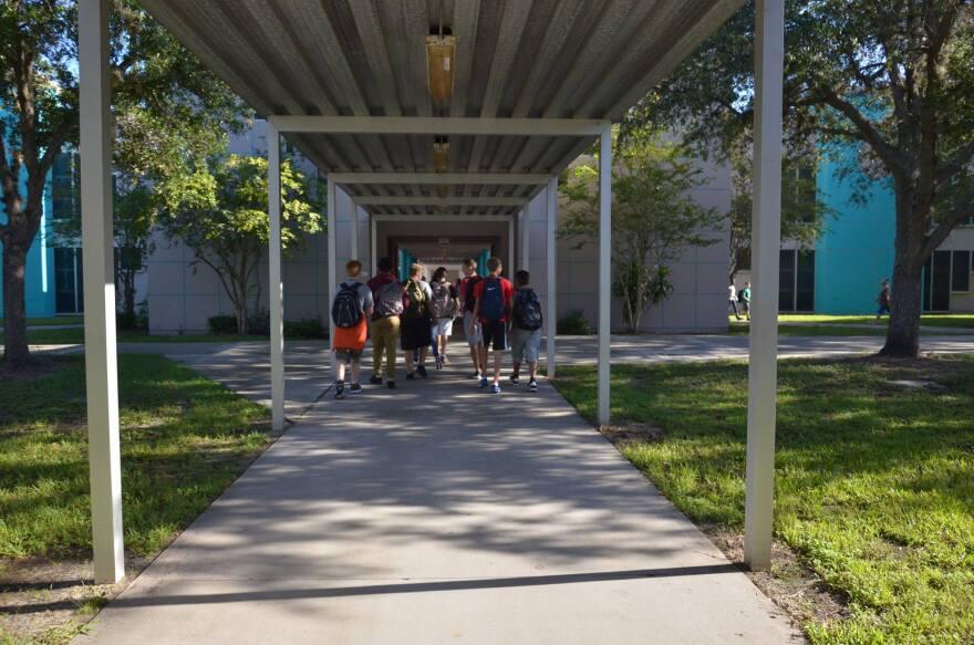 children entering school building