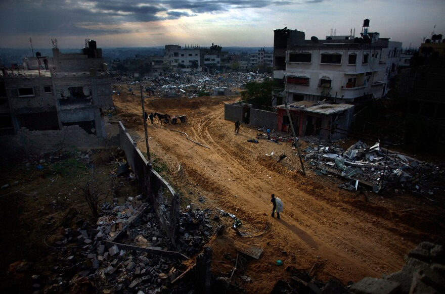 The Twam neighborhood of Gaza lies in ruins as residents try to pick up the pieces on Jan. 19, 2009. A tenuous cease-fire held that day in Gaza, where Palestinians dug out from the rubble.
