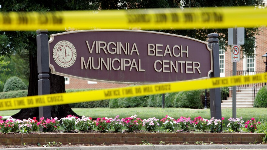 Police tape frames a sign at one of the entrances to the municipal government complex where a dozen people were shot to death earlier this year in Virginia Beach, Va.