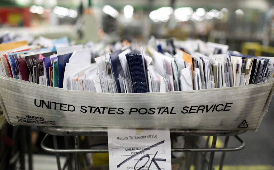 Cartons of mail ready to be sorted sit on a shelf at the U.S. Post Office sort center in San Francisco, California.
